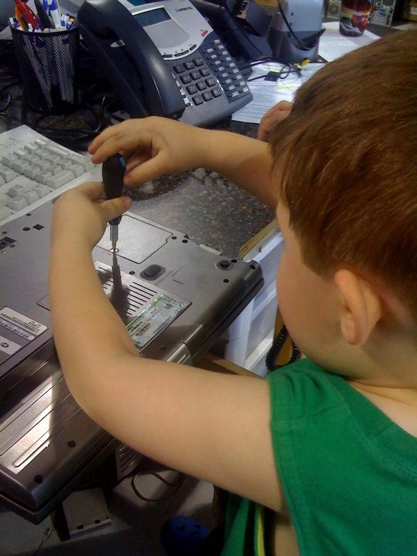 Jacob Schrock Fixing Laptop